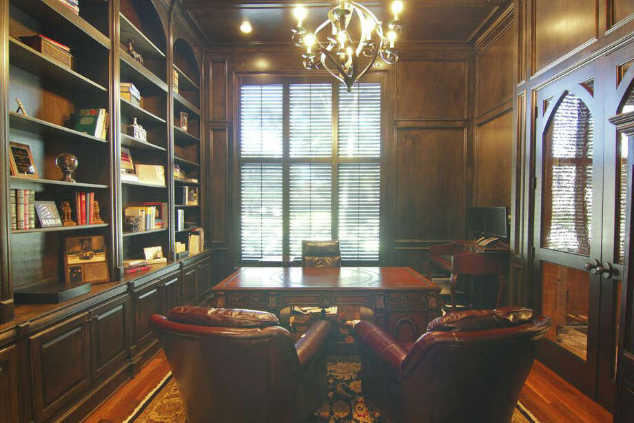 The study has solid wood shelves, large windows and glass-door display cases. Photo: Better Homes And Gardens Real Estate