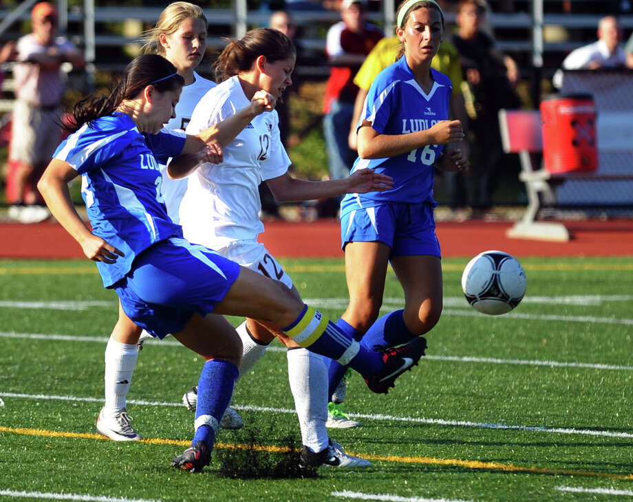 Fairfield Ludlowe's Allyson Doyle kicks the ball away as St. Joseph's Sylvia Yanaz during the Falcons' game with the Cadets on Sept. 12. Photo: Christian Abraham / Connecticut Post