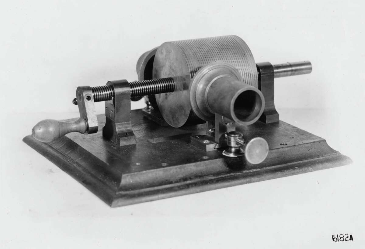 This photo provided by the Museum of Innovation and Science in Schenectady, N.Y., shows Thomas Edison's 1878 tinfoil phonograph. Researchers have digitized what experts say is the oldest recording of a playable American voice and history?'s first-ever recorded musical performance, along with the first recorded blooper. Recorded on a sheet of tinfoil on a phonograph invented by Thomas Edison, the recording was made in St. Louis in 1878. It contains a short coronet solo of an unidentified song, followed by the voices of a man reciting popular nursery rhymes. (AP Photo/Mike Groll)