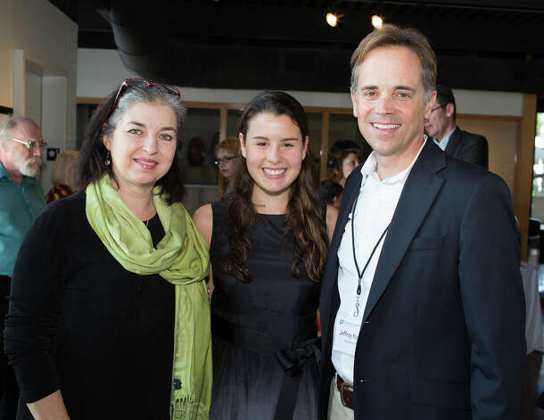 Donating artist Ana Laura de la Garza, from the left, architecture student Sydney Moore and Planned Parenthood Trust of South Texas president and CEO Jeffrey Hons get together at the trust event honoring U.S. Congressman Charlie Gonzalez at Gallery Nord, Sunday, October 21, 2012 Photo: J. MICHAEL SHORT, FOR THE EXPRESS-NEWS / THE SAN ANTONIO EXPRESS-NEWS