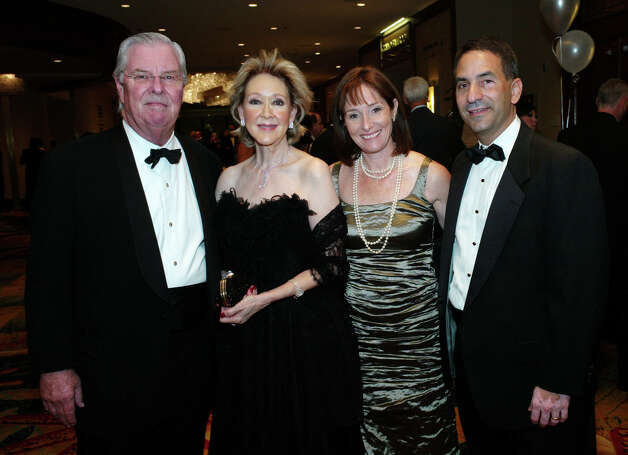 OTS/HEIDBRINK - Honorees and spouses, Vernon Torgerson, from left, Nancy Torgerson and co chairs and spouses Allison Kustoff and Danny Kustoff gather at the Blood & Tissue Center Foundation Ball at the Omni Hotel on 10/20/2012. This is #1 of 2 photos. names checked photo by leland a. outz Photo: LELAND A. OUTZ, SPECIAL TO THE EXPRESS-NEWS / SAN ANTONIO EXPRESS-NEWS
