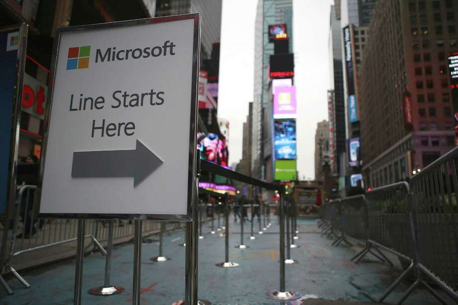 A line awaits customers Thursday morning ahead of the opening of the Times Square Microsoft store on October 25, 2012 in New York City. The official store opening was scheduled for Thursday night ahead of Friday's release of the long-awaited Microsoft Surface tablets and the Windows 8 operating system. Photo: John Moore, Getty Images / 2012 Getty Images