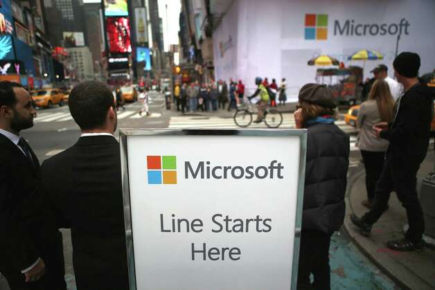 Microsoft employees await customers Thursday morning ahead of the opening of the Times Square Microsoft store on October 25, 2012 in New York City. The official store opening was scheduled for Thursday night ahead of Friday's release of the long-awaited Microsoft Surface tablets and the Windows 8 operating system. Photo: John Moore, Getty Images / 2012 Getty Images