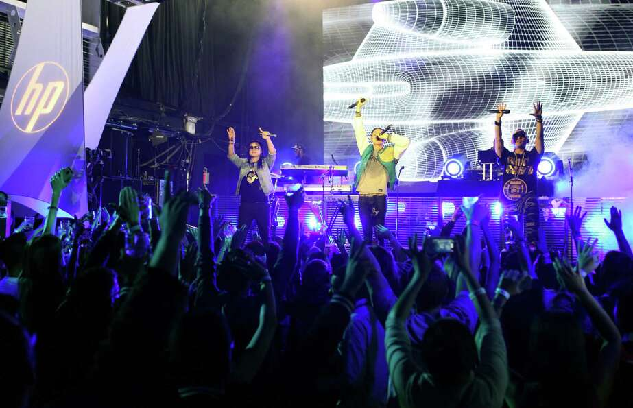 In this photo provided by HP, Far East Movement performs to celebrate the launch of HP's new line of