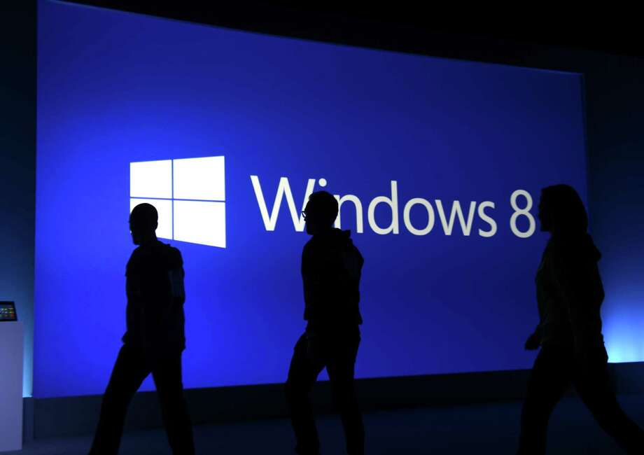 staffers walk on the stage following a press conference to  officially launch Windows 8 at Pier 57 in New York October 25, 2012. Photo: TIMOTHY A. CLARY, AFP/Getty Images / 2012 AFP