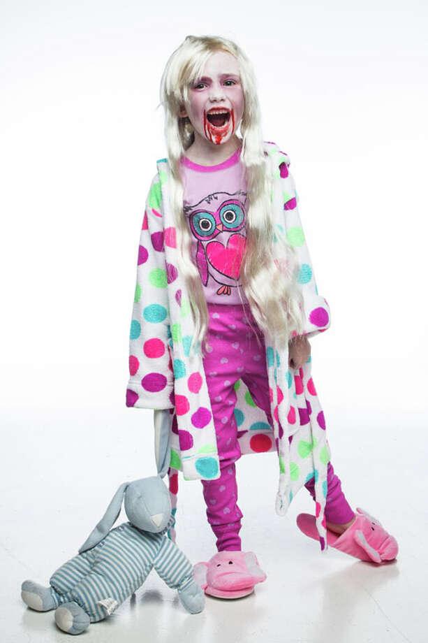 "Hazel Britton-Dansby is the little zombie girl from ""Walking Dead,"" Monday, Oct. 22, 2012, in Houston. ( Michael Paulsen / Houston Chronicle ) Photo: Michael Paulsen, Houston Chronicle / © 2012 Houston Chronicle"