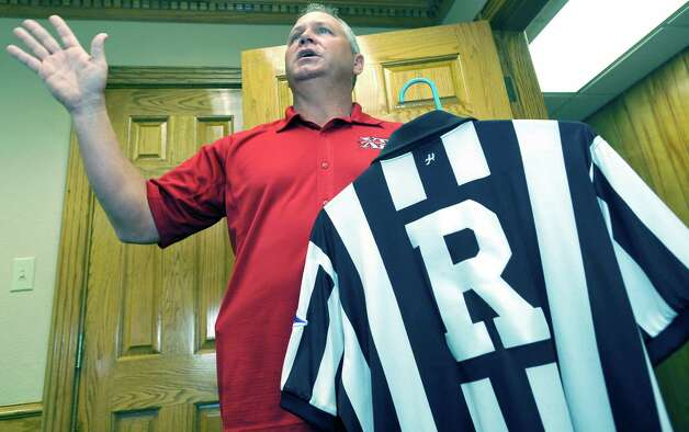 Mike Defee, is a football referee for the Big 12 conference. Defee, who lives in Mauriceville, and was at his office at Newtron Inc., Wednesday morning October 17, 2012, before he left for his next game in Reno Nevada later in the day.  Dave Ryan/The Enterprise