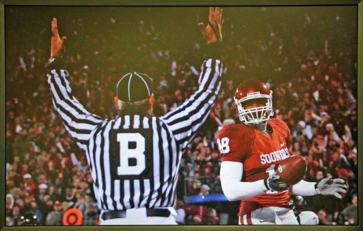 This is a picture that is on Mike Defee's computer screen of him signaling a touchdown as a backfield judge in the 2008 Oklahoma and Texas Tech game. Defee, is a football referee for the Big 12 conference. He lives in Mauriceville, and was at his office at Newtron Inc., Wednesday morning October 17, 2012, before he left for his next game in Reno Navada later in the day. Dave Ryan/The Enterprise