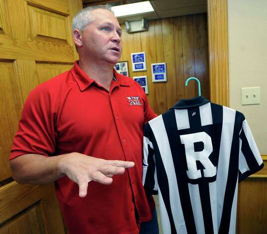 Mike Defee, is a football referee for the Big 12 conference. Defee, who lives in Mauriceville, and was at his office at Newtron Inc., Wednesday morning October 17, 2012, before he left for his next game in Reno Nevada later in the day.  Dave Ryan/The Enterprise Photo: Dave Ryan