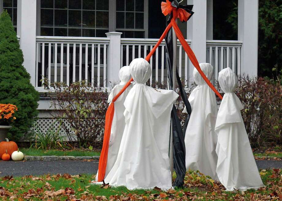 A ghostly group gathers on the front lawn of a Mill Plain Road home. Photo: Genevieve Reilly