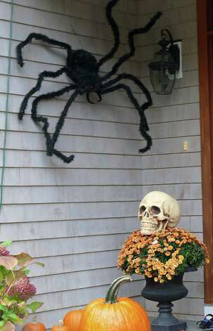 A South Street home is protected by outsized spider, and a rather large skull. Photo: Genevieve Reilly