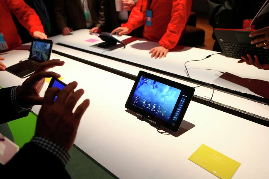 Guests try out new Microsoft Windows 8 products during the company's Windows 8 and Surface event in New York, Oct. 25, 2012. Microsoft threw a coming-out party on Thursday for their new operating system and tablet, its most significant new products in years. (Chang W. Lee/The New York Times) Photo: CHANG W. LEE, New York Times / NYTNS