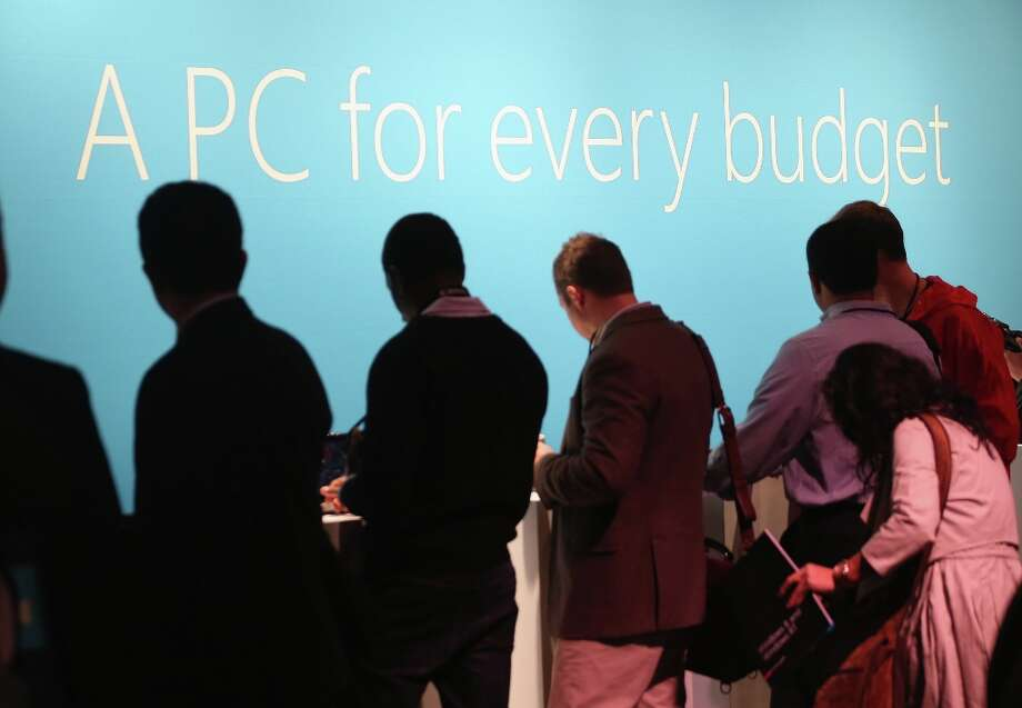 NEW YORK, NY - OCTOBER 25:  People look at the Microsoft Windows 8 operating system at a press conference launch of the system on October 25, 2012 in New York City.  Windows 8 will offer a touch interface in an effort to bridge the gap between tablets, smartphones and personal computers. Microsoft will also be selling a tablet called Surface to compete in the competitive tablet market.  (Photo by Mario Tama/Getty Images) Photo: Mario Tama, Getty Images / 2012 Getty Images