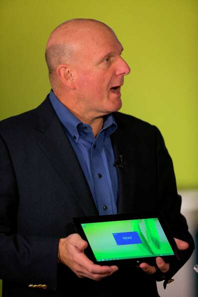 Steve Ballmer, chief executive officer of Microsoft Corp., looks at the new Surface tablet during an