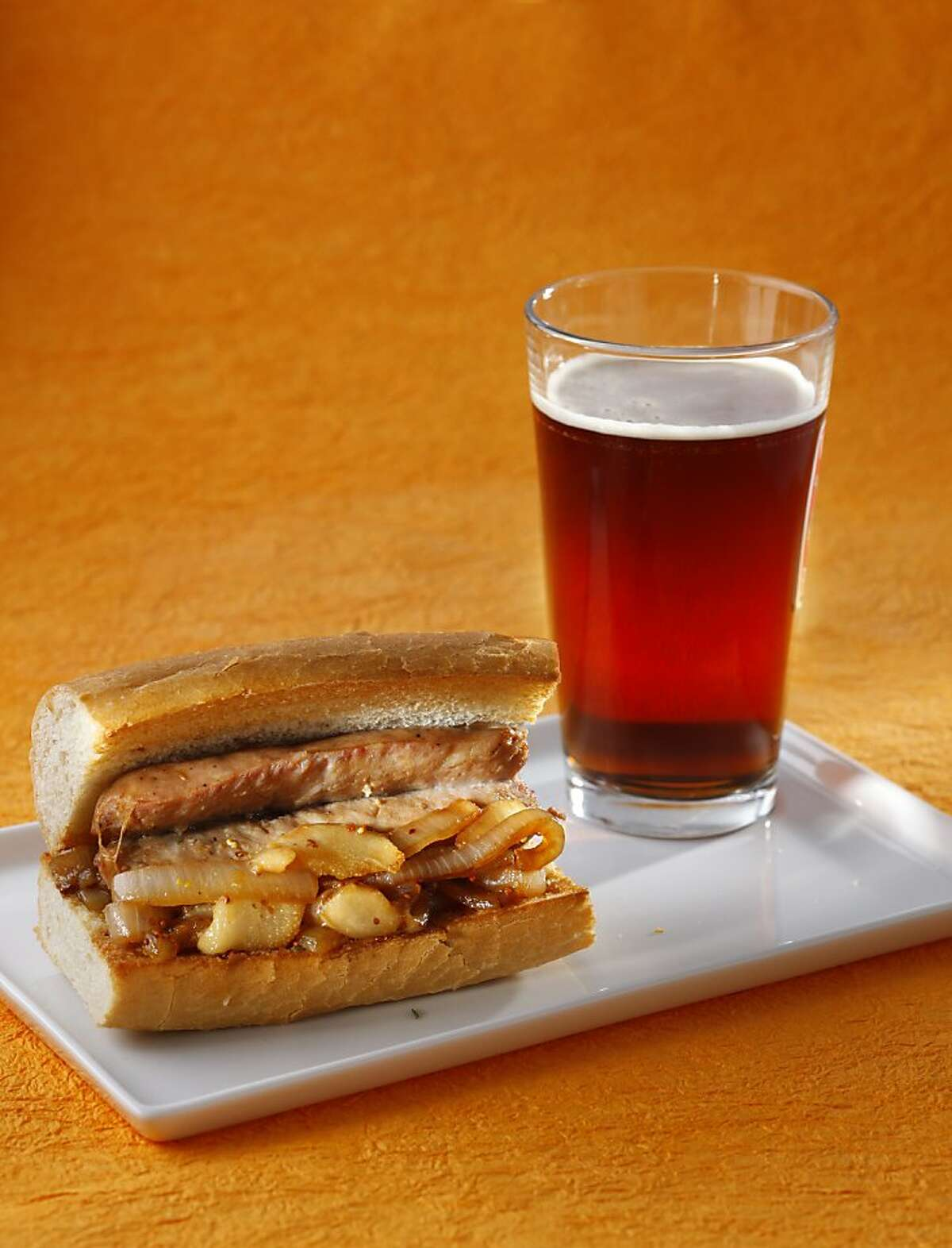 Beer-Braised Brats With Pear & Mustard Compote; styling by Amanda Gold