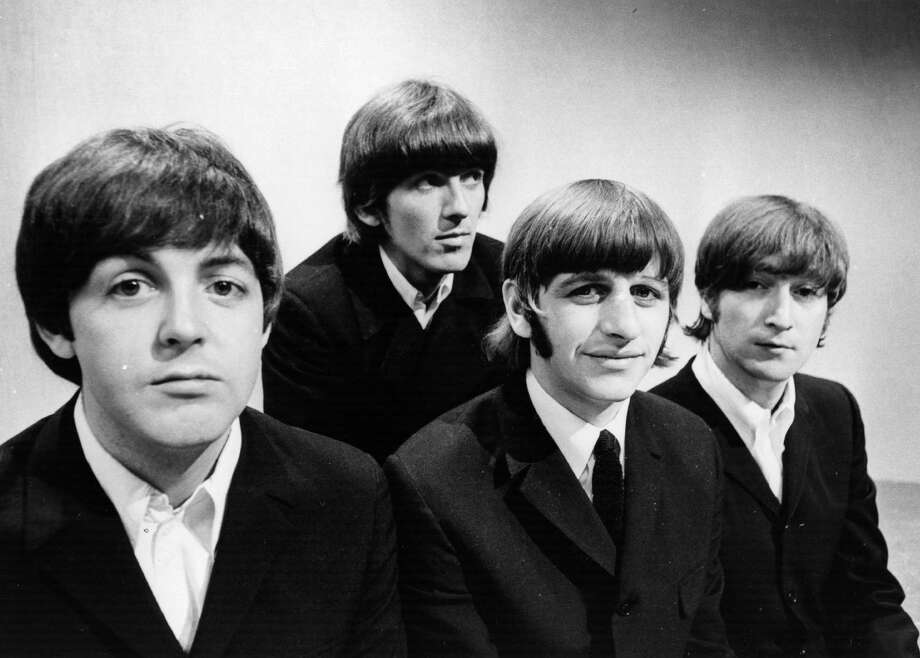 50 Years Since The First Beatles Single Released: A Look Back At The Beatles   Portrait of British pop group The Beatles (L-R) Paul McCartney, George Harrison (1943 - 2001), Ringo Starr and John Lennon (1940 - 1980) at the BBC Television Studios in London before the start of their world tour, June 17, 1966. Photo: Central Press, Getty Images / 2003 Getty Images