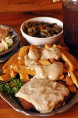 Chicken Fried Steak with gravy covered steak fries from the Little Red Barn Steakhouse. (SPECIAL TO THE EXPRESS-NEWS)