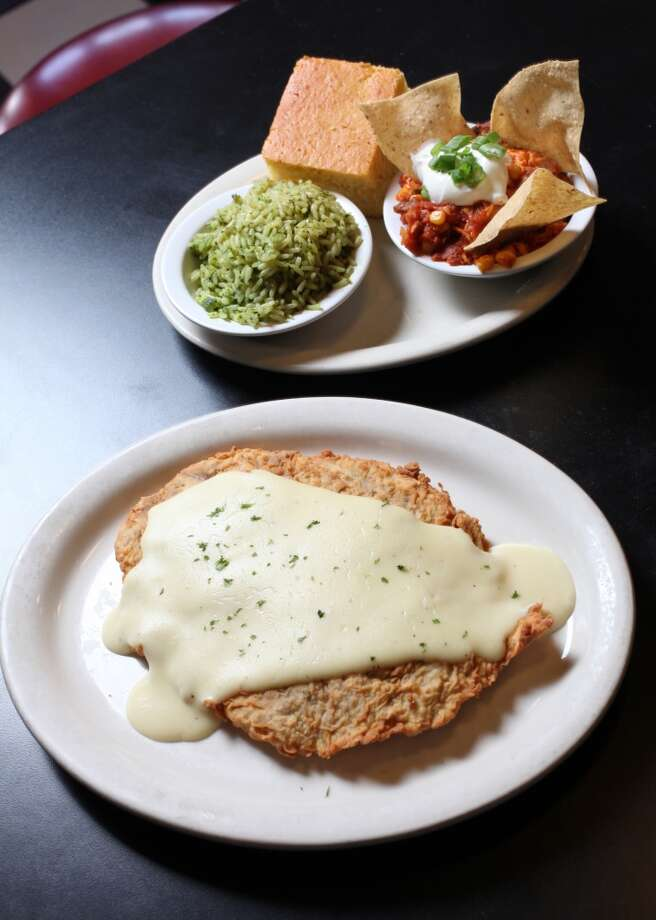 READERS CHOICE 2012 Chicken Fried Steak with Poblano Rice, Sonora Casserole and homemade cornbread from Checkers Diner. (San Antonio Express-News)