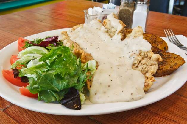The Country Chicken Fried Steak at La Tuna Grill, 100 Probandt St., is served with rosemary roasted potatoes and a side salad. (PRIME TIME NEWSPAPERS)