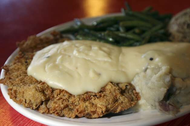 The Chicken Fried Steak with mashed Potatoes and green beans at the Hungry Horse in Boerne, Tx.  (SAN ANTONIO EXPRESS-NEWS)