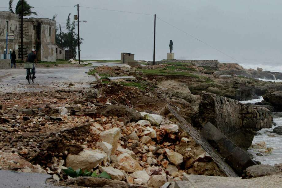 The sea wall and a road is partially damaged after the passing of Hurricane Sandy in Gibara, Cuba, Thursday, Oct. 25, 2012.  Hurricane Sandy blasted across eastern Cuba on Thursday as a potent Category 2 storm and headed for the Bahamas after causing at least two deaths in the Caribbean. Photo: Franklin Reyes, Associated Press / AP