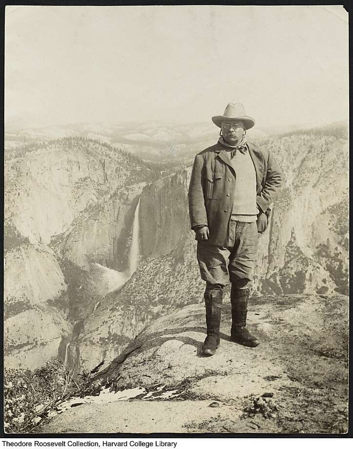 In a photograph taken in 1903, Theodore Roosevelt stands atop Glacier Point in Yosemite Valley. A new, yearlong exhibition at the American Museum of Natural History in New York will explore the president's love of nature and conservationism. Photo: Courtesy Houghton Library, Harvard University