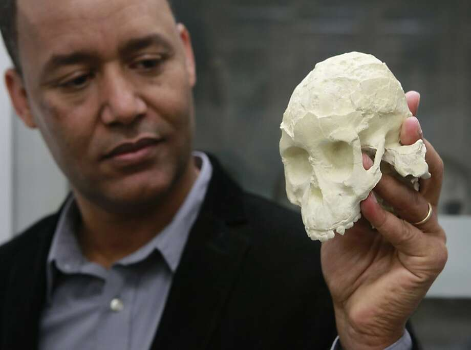 Zereseney Alemseged of the California Academy of Sciences with a cast of a 3.3 million-year-old prehuman skull fossil. Photo: Paul Chinn, The Chronicle