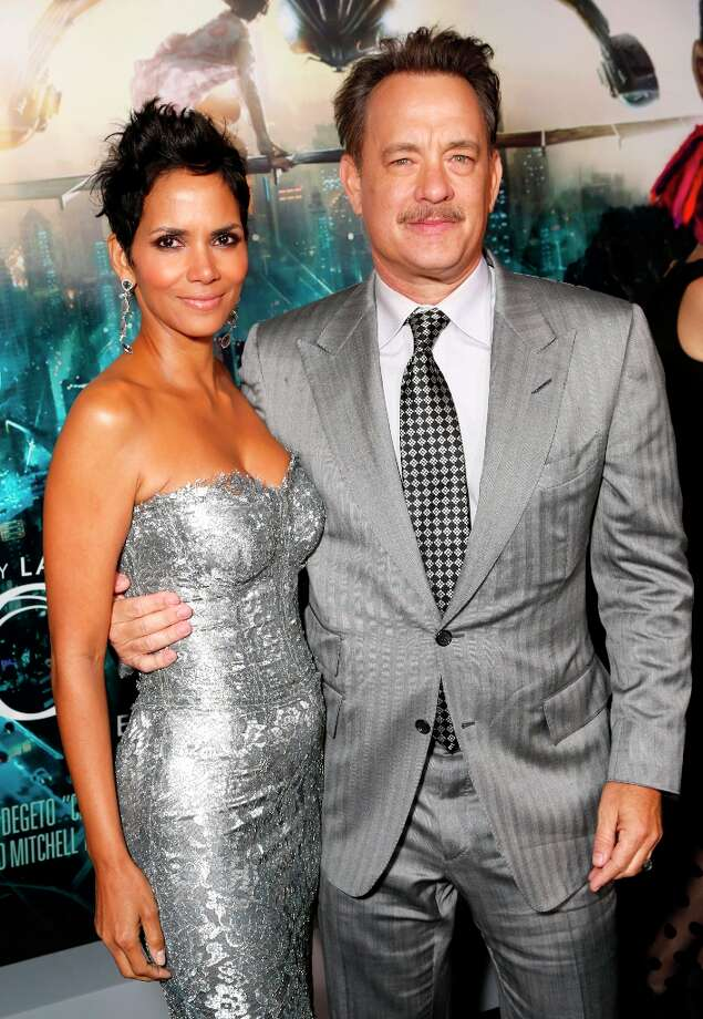 "Halle Berry and Tom Hanks pose for photographers at the Los Angeles premiere of ""Cloud Atlas"" at Grauman's Chinese Theatre on Wednesday, Oct. 24, 2012, in Hollywood, Calif. Photo: Todd Williamson, Associated Press / Invision"
