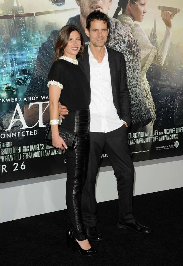 "Director Tom Tykwer (R) and Marie Steinmann arrive at Warner Bros. Pictures' ""Cloud Atlas"" premiere at Grauman's Chinese Theatre on October 24, 2012 in Hollywood, California. Photo: Jason Merritt, Getty Images / 2012 Getty Images"