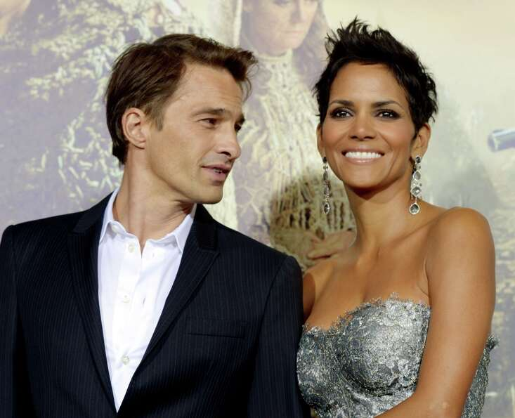 Actress Halle Berry (R) and actor Olivier Martinez arrive at the premiere of Warner Bros. Pictures'