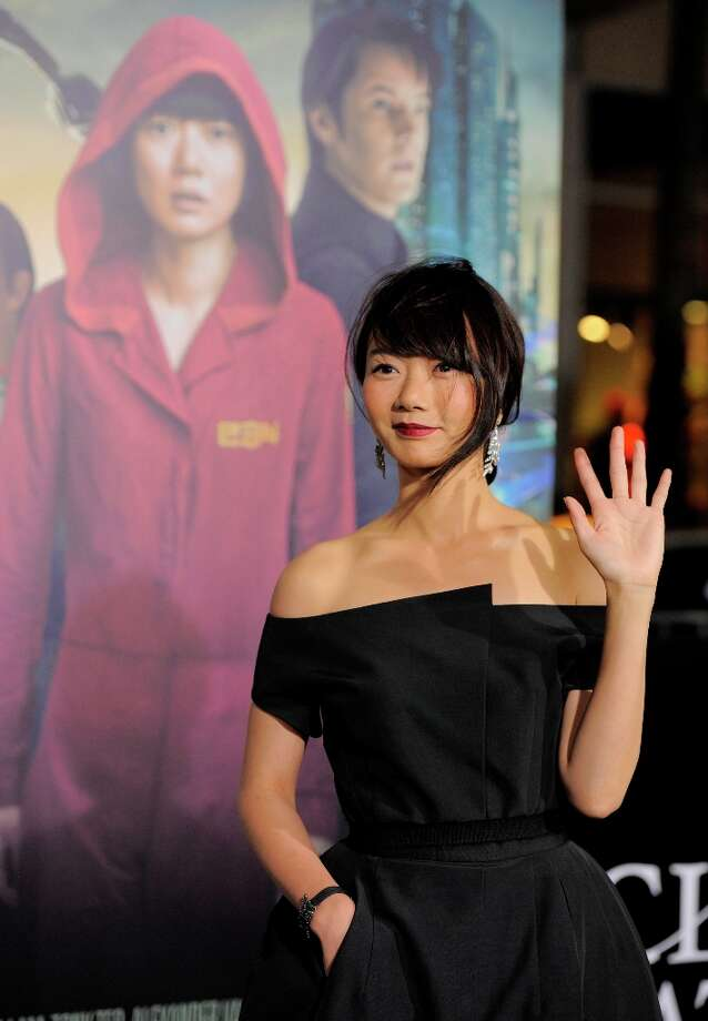 "South Korean actress Doona Bae, a cast member in ""Cloud Atlas,"" waves to photographers at the premiere of the film at Grauman's Chinese Theatre on Wednesday, Oct. 24, 2012, in Los Angeles. Photo: Chris Pizzello, Associated Press / Invision"
