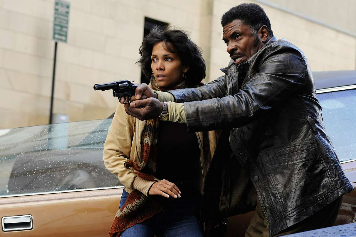 This film image released by Warner Bros. Pictures shows Halle Berry, left, and David Keith in a scene from