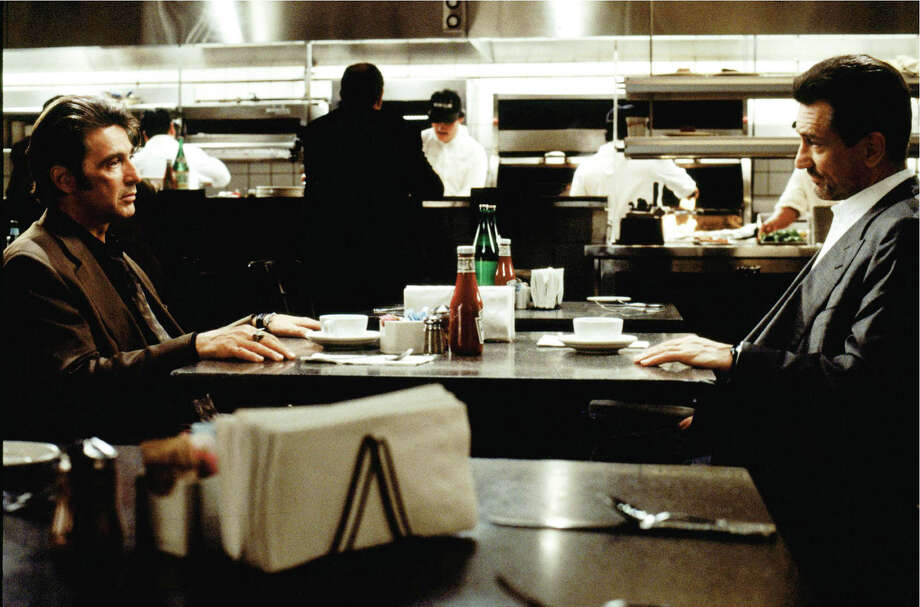 "This 1995 photo released by Warner Bros Pictures shows Al Pacino as Vincent Hanna, left, and Robert De Niro as Neil McCauley in a scene from ""Heat."" (AP Photo/Warner Bros. Pictures)"