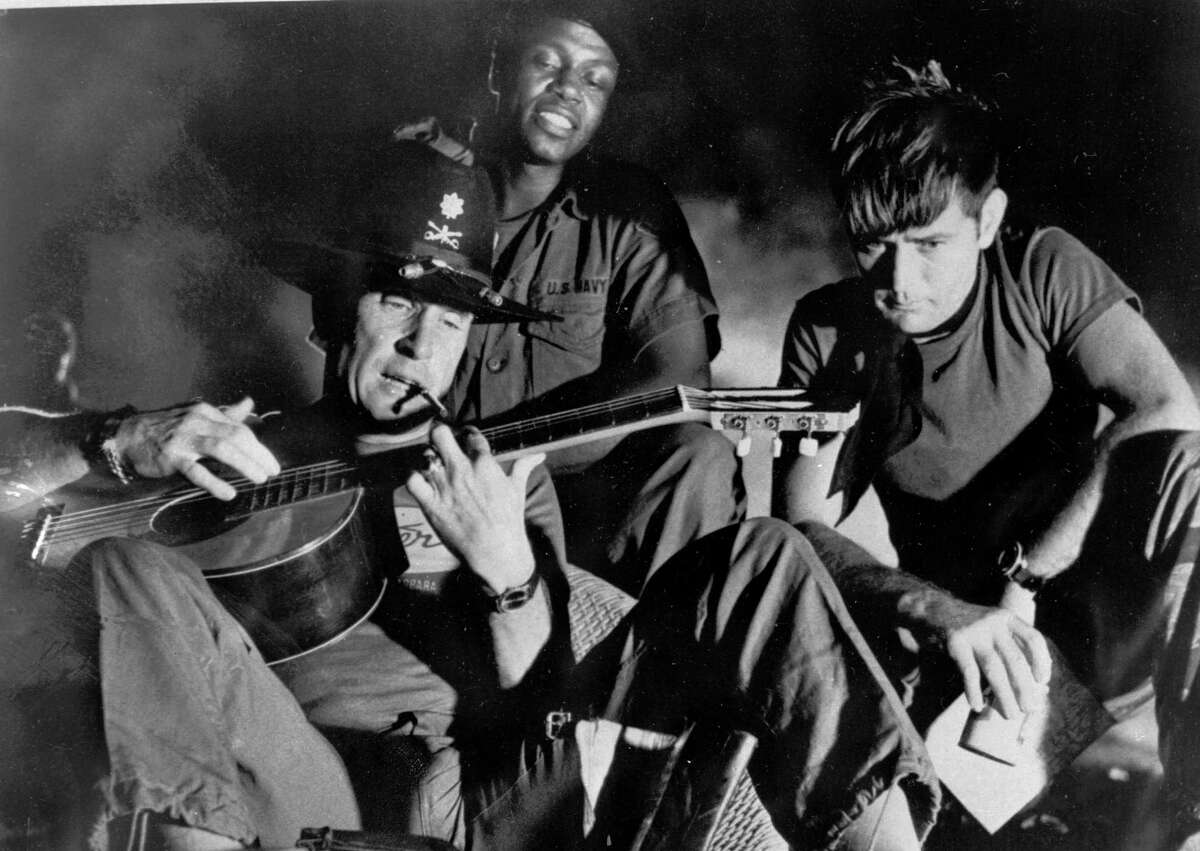 """FILE - In this undated file photo released by United Artists, from left, Robert Duvall as Lt. Col. Kilgore, Albert Hall as Chief and Martin Sheen as Capt. Willard, are shown in the film """"Apocalypse Now,"""" a United Artists release. In 2001 director Francis Ford Coppola released """"Apocalypse Now Redux,"""" a new version of 1979 classic that adds 53 minutes of previously unseen footage. (AP Photo/United Artists, File)"""