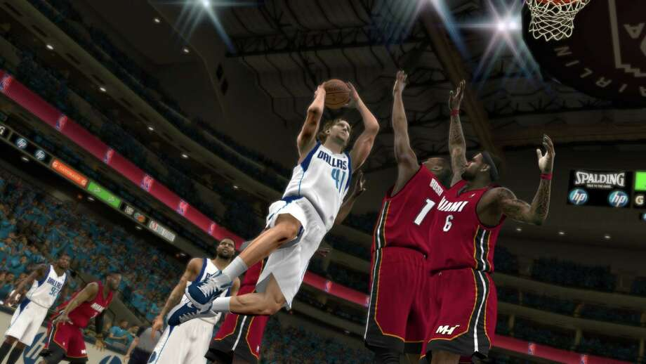 "In this video game image released by 2K Sports, an animated likeness of Dallas Mavericks' Dirk Nowitzki takes a shot against the Miami Heat in ""NBA 2K12"" (AP Photo/2K Sports)"