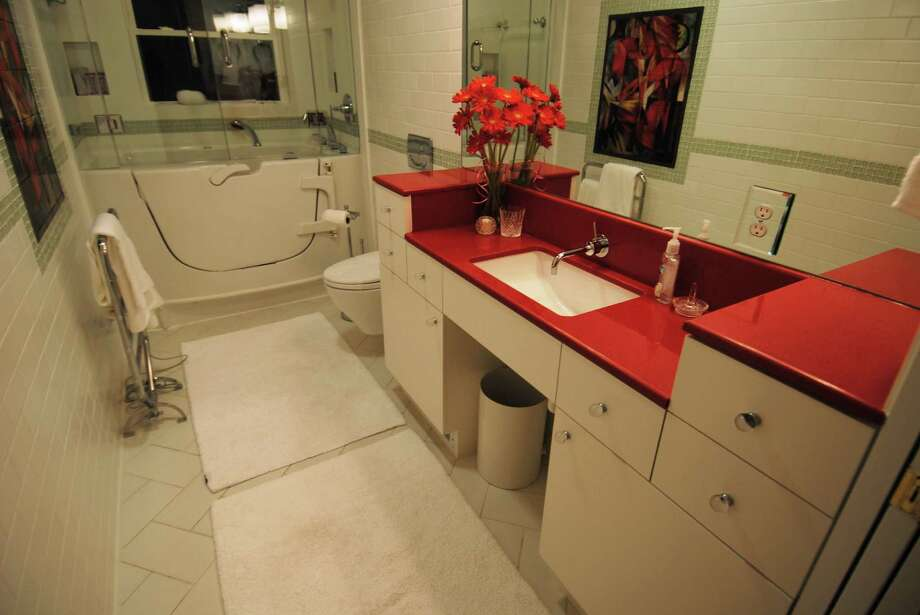 A well-designed bathroom built to accommodate a wheelchair user also might suit grandchildren with limited reach.