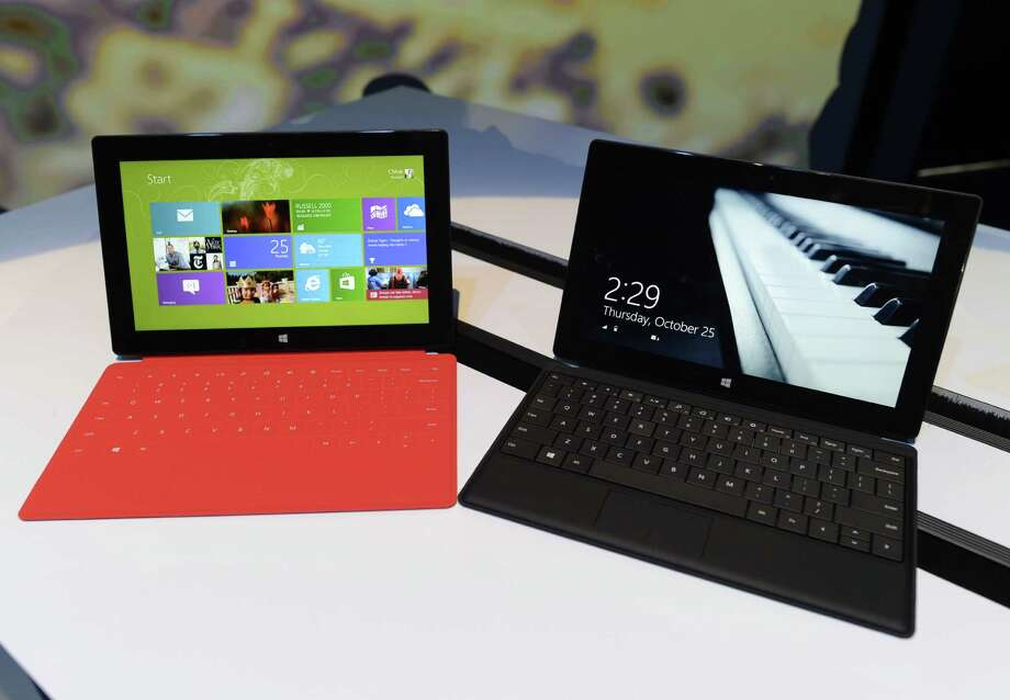 The new Microsoft Surface tablet  on display following  a press conference at Pier 57 to  officially launch Windows 8  and the tablet in New York  October 25, 2012. Microsoft took a big step into mobile Thursday, unveiling a revamped version of its flagship Windows system and a offering a closer look at Surface, its entry into the hot tablet market. The new Windows 8 operating system and tablet to go on sale Friday mark a new offensive for the US tech giant seeking to keep pace with Apple and Google amid a dramatic shift away from PCs to mobile devices. AFP PHOTO / TIMOTHY A. CLARYTIMOTHY A. CLARY/AFP/Getty Images Photo: TIMOTHY A. CLARY, AFP/Getty Images / AFP