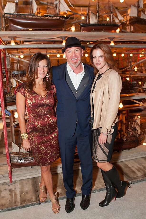 Philanthropist Chris Bentley, (center) who owns the Bentley Reserve building in San Francisco, is more of a Burning Man fan, but occasionally takes in some of the city's more staid events like the Fall Antiques Show on Oct. 24, where he is seen with public relations woman Claudia Ross (left) and Nicole Saidi (right.) Photo: Drew Altizer Photography