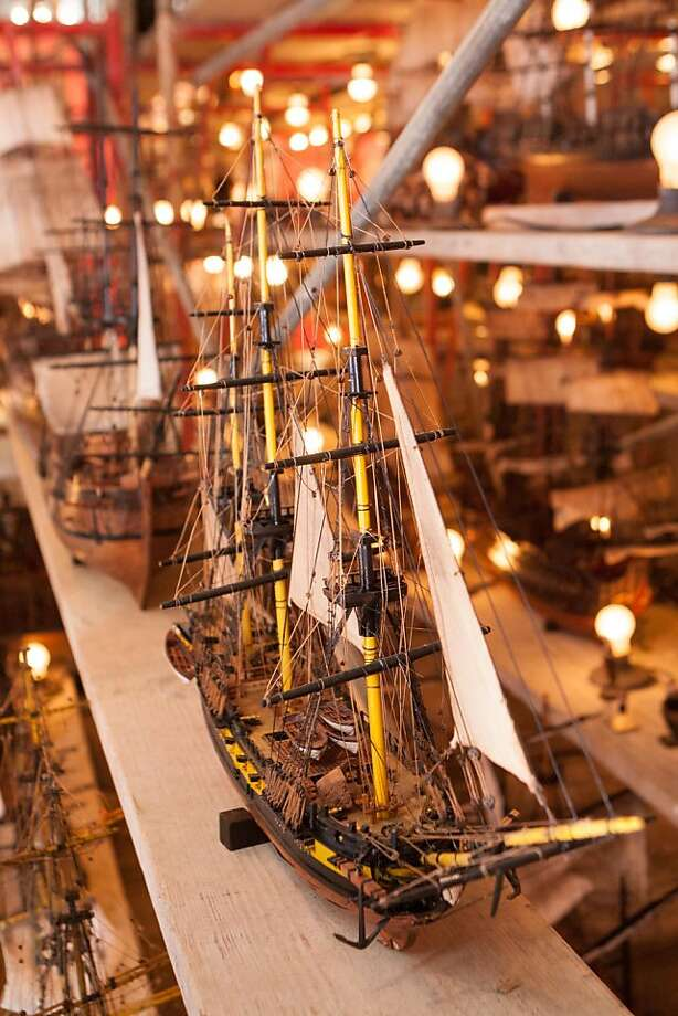 One of the highlights of the Fall Antiques Show is the massive art piece by Ron Pippin that greets guests on the left side of the exhibition hall at Fort Mason. The piece is made of 120 old ships, placed on shelves, and was brought to the show by interiors dealer Ray Azoulay of Obsolete, in Venice, Calif. Photo: Drew Altizer Photography