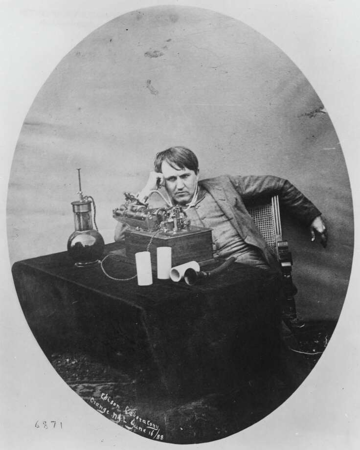 This 1888 photo provided by the Museum of Innovation and Science in Schenectady, N.Y., shows Thomas Edison listening to a wax cylinder phonograph. Photo: Uncredited, HOEP / Museum of Innovation and Science