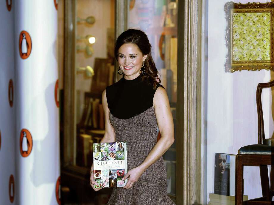 """Pippa Middleton, sister to the Duchess of Cambridge, formerly known as Kate Middleton, poses for the media as she arrives at a bookshop to promote her new book """"Celebrate: A Year of British festivities for families and friends"""", in London Thursday, Oct. 25, 2012. (AP Photo/Kirsty Wigglesworth) Photo: Kirsty Wigglesworth"""