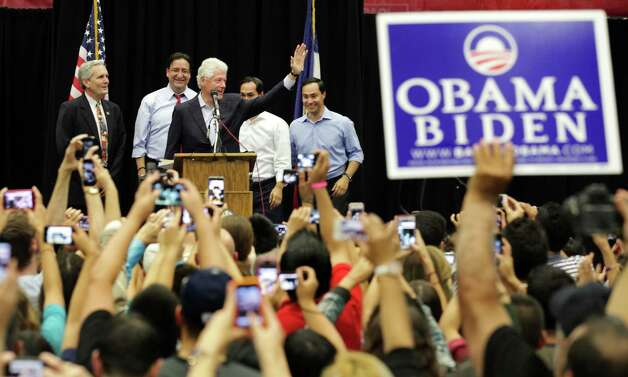 Former President Bill Clinton greets the crowd at South San High School in San Antonio to show support for Pete Gallego and other Democrats running in the upcoming election.  Behind him are Lloyd Doggett, Pete Gallego, Julian Castro, and Joaquin Castro.  Thursday, Oct. 25, 2012. Photo: Bob Owen, San Antonio Express-News / San Antonio Express-News