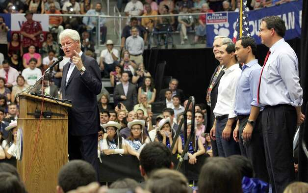 Former President Bill Clinton, left, speaks at South San High School in San Antonio at a Democrate rally, with Lloyd Doggett, Julian Castro, Joaquin Castro, and Pete Gallago at right.   Thursday, Oct. 25, 2012. Photo: Bob Owen, San Antonio Express-News / San Antonio Express-News
