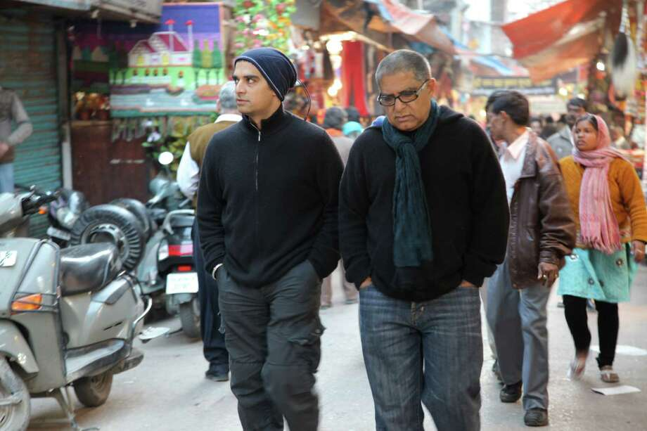 "Director Gotham, left, tags along with dad Deepak Chopra on his travels in ""Decoding Deepak."" Photo: Nala Films"