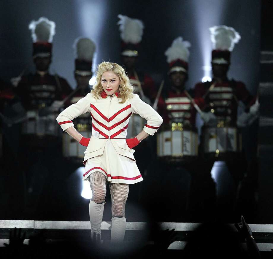 Madonna performs the first of two sold-out shows at Toyota Center. Her MDNA Tour is fast-paced, playful and serious. Despite a late start, fans weren't disappointed. Photo: Karen Warren, Staff / Houston Chronicle