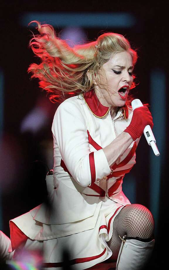 Madonna used a gun as a prop at a show in Denver months after a tragic shooting happened there. Not the smartest idea.  Photo: Karen Warren, Staff / Houston Chronicle