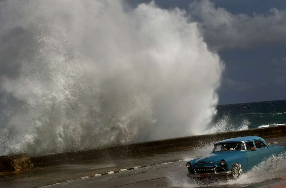 Hurricane Sandy slams Cuba, sending waves crashing against the Malecon in Havana, before heading for the Bahamas and menacing the U.S. East Coast. Photo: Ramon Espinosa, Associated Press