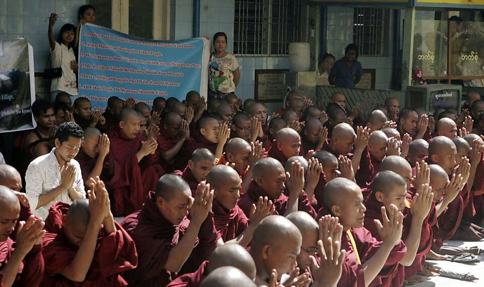 Monks pray during a rally in Rangoon, Burma, against violence between Buddhists and Muslims.