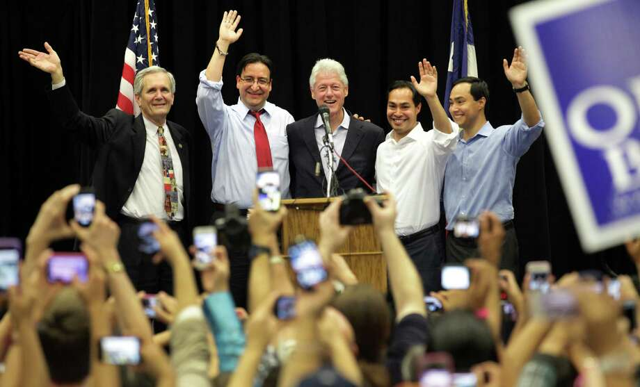 Former President Bill Clinton, center, surrounded by Lloyd Doggett, left to right, Pete Gallego, Julian Castro, and Joaquin Castro, greet the crowd at South San High School in San Antonio to show support for Pete Gallego and other Democrats running in the upcoming election.  Thursday, Oct. 25, 2012. Photo: Bob Owen, San Antonio Express-News / © 2012 San Antonio Express-News