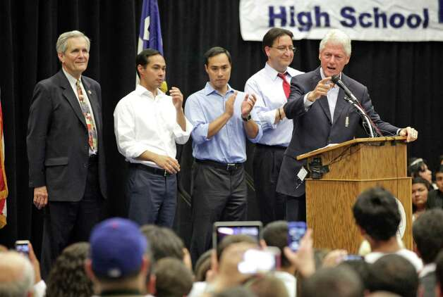 Former President Bill Clinton, right, speaks at South San High School in San Antonio to show support for Pete Gallego and other Democrats running in the upcoming election.  Behind him are Lloyd Doggett, Julian Castro, Joaquin Castro, and Pete Gallego.  Thursday, Oct. 25, 2012. Photo: Bob Owen, San Antonio Express-News / San Antonio Express-News